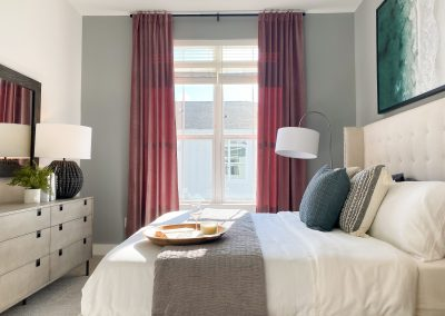 main bedroom with large windows