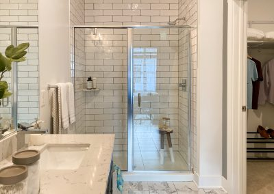 main bathroom with walk in shower and closet