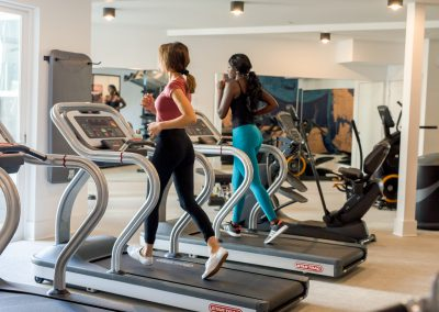 two people running in gym