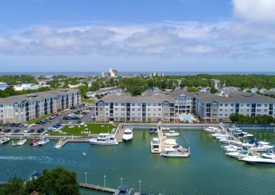 drone shot of waterfront apartment community